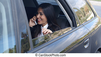 Laughing young executive on phone in car - Laughing young...
