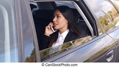 Beautiful business woman on phone in automobile - Beautiful...