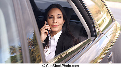 Beautiful business woman on phone in automobile - Beautiful...