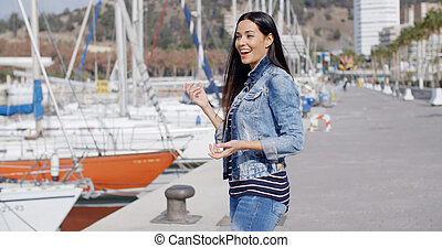 Attractive casual young woman standing laughing