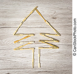 Coniferous tree of toothpicks on the wooden background...
