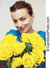 Young brunette posing with yellow roses, beauty and fashion...