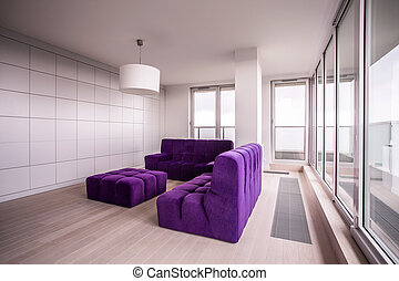 Purple and cozy furnitures in the living room