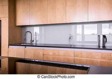 Cabinets in the kitchen - Wooden and clean cabinets in the...