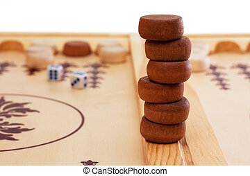 Backgammon pieces - A stack of game pieces at a backgammon...