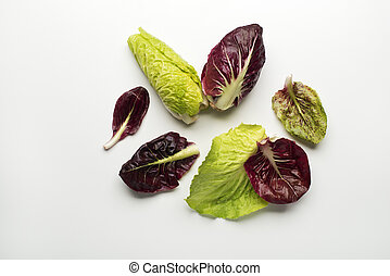 Salad leaves - Fresh mixed salad leaves with radicchio on a...