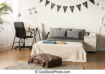 Stylish bedroom for teenager who love traveling