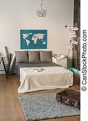 Bedroom for couple of travelers - World map in bedroom for...
