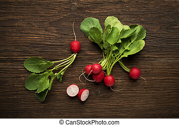 Red radish - Fresh red radish on wooden background close up