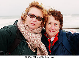 Portrait of beautiful senior woman and her adult daughter
