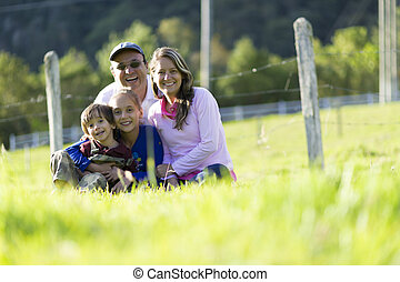 Happy Family Outdoors - Portrait of Happy Family, Father,...