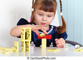 Child playing with dominoes - A child playing with dominoes...