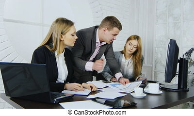 A group of businessmen at work in the office