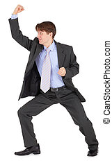 Young man beats his fist on white background