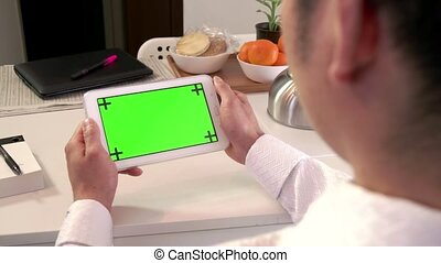 Internet Green Screen Monitor iPad - Asian man touching...