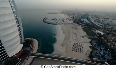 Burj Al Arab hotel in Dubai, UAE. Helicopter view - Fly over...