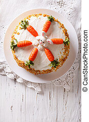 cake decorated with bunny and carrot vertical top view -...