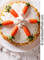 carrot cake with candy bunny close-up on the table vertical...