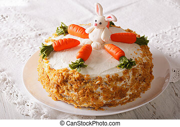 carrot cake with candy bunny close-up on the table...