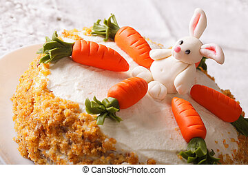 Celebratory cake decorated with carrot and bunny close-up on...