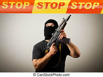 Man with gun and STOP line. - Man in mask with gun and STOP...