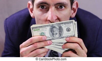 Greedy Businessman sniffing money - Businessman counts...