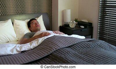 Morning Man Waking Up In Home Bed - Asian people sleeping in...