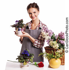 Gardening. Woman with flowers. Isolated over white background