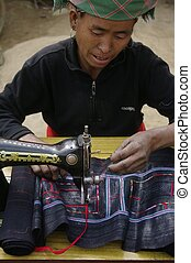 Black Hmong woman sewing machine - Black Hmong woman at her...