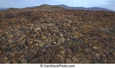 Fly Over Rock Mountain - Fly over a pile of rocks with...