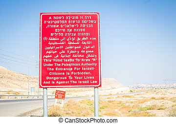 Warning sign for Israelites on the border with Palestinian...