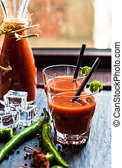Fresh tomato juice with cherry tomatoes and chili pepper on...