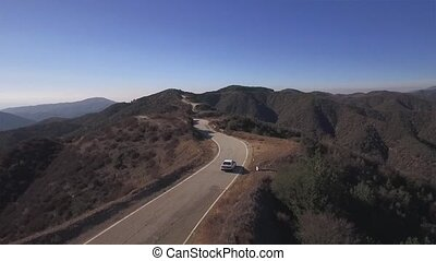 Car Driving In Windy Road - Aerial HD footage from behind a...