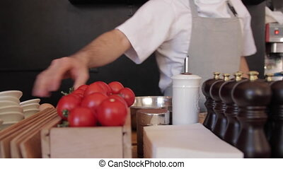 fuss in a restaurant kitchen - chef working in the kitchen