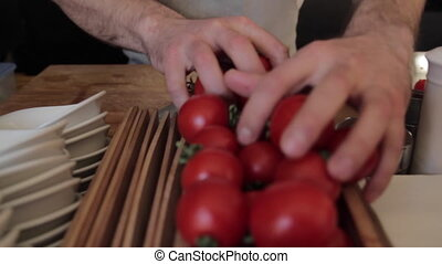 sorting tomatoes by hands - Chef shifts by hands the...