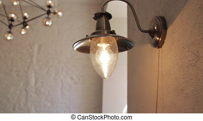 lamp wall turns on and off - lamp in a restaurant on the...