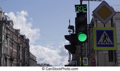 street lights - traffic light turns green, yellow and red