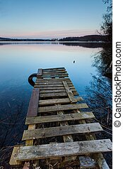 Lake landscape with small old wooden pier photographed on...