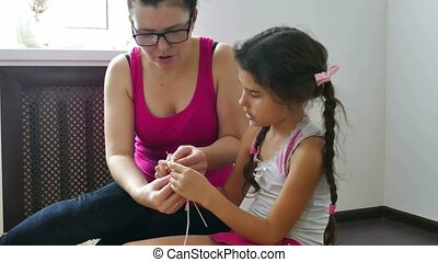 woman and a teen girl knit knitting needlework lifestyle -...