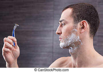 Cheerful strong guy is preparing for shaving - I am ready to...
