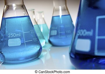 laboratory equipment - group of glass flasks with blue...