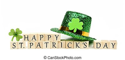 Happy St Patricks Day wooden blocks with leprechaun hat and...