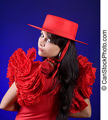 Spanish look - Young Spanish flamenco dancer posing in a red...