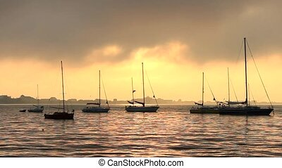 sailboats in the bay at sunrise