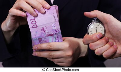 Businesswomen Counts Money and Stopwatch. - Business woman...