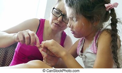 woman and teen girl knitting needlework lifestyle knit -...