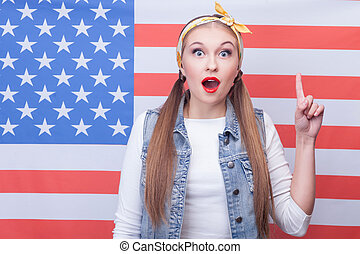 Cheerful young American woman has a great idea - Eureka...