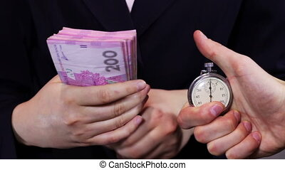 Business Women Counts Money and Stopwatch - Business woman...
