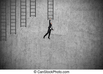Businessman in suit hung on ladder
