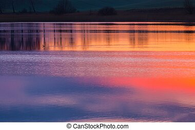 Beautiful lake with colorful sunset sky refected in water....